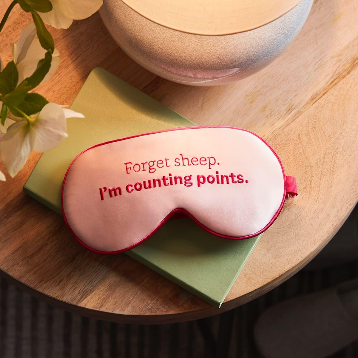 Pink Adjustable Silk Eye Mask - front of mask on nightstand