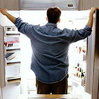Man in front of open fridge