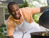 man at barbecue grill