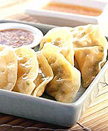 Photo of Steamed Vegetable Dumplings with Two Dipping Sauces by WW