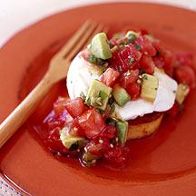 Photo of Mexican poached eggs over polenta with tomatillo-avocado salsa by WW