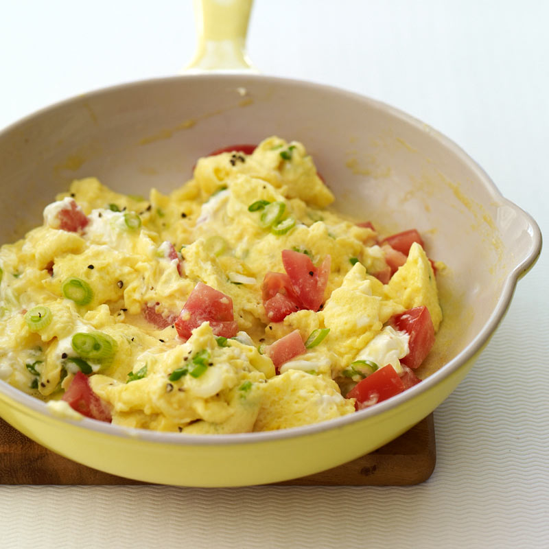 Photo of Creamy scrambled eggs with scallions and tomatoes by WW