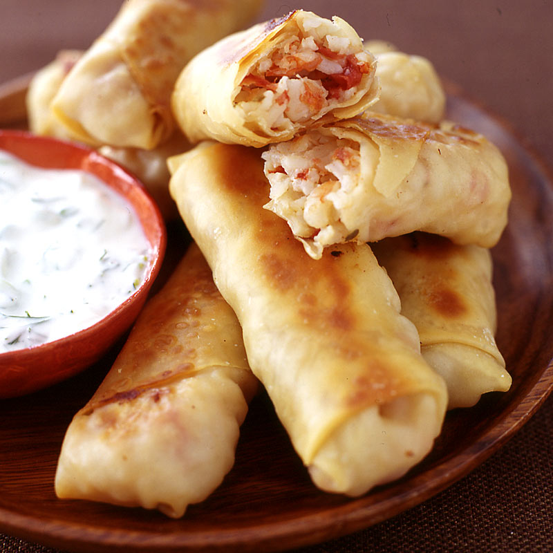 Photo of Greek-style egg rolls with a garlic-dill dipping sauce by WW