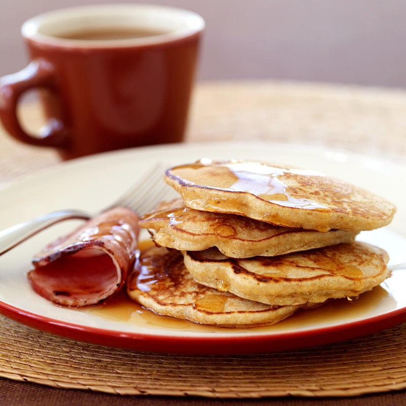 Photo of Multi-grain pancakes with Canadian bacon and maple syrup by WW