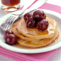 Photo of Oatmeal-buttermilk pancakes topped with cherries by WW