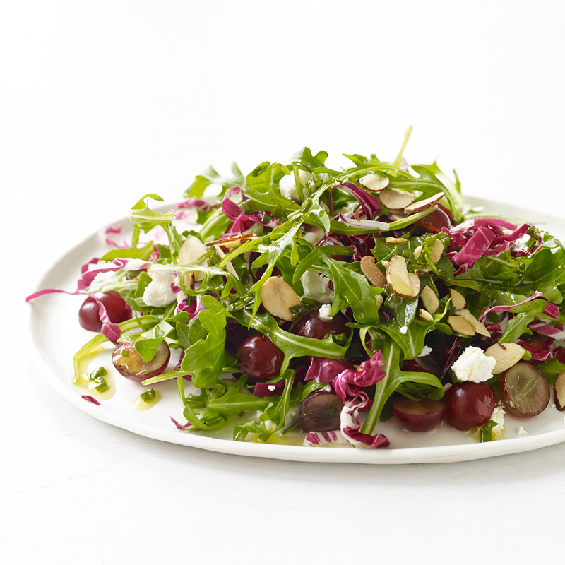 Photo of Arugula and radicchio with grapes, goat cheese, and Champagne vinaigrette by WW