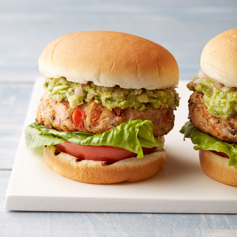 Photo of Mexican turkey burgers with mashed avocado spread by WW