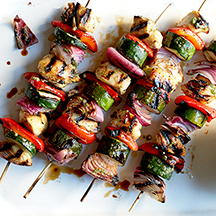Mojo-Marinated Chicken and Vegetable Kebabs with Mixed Greens