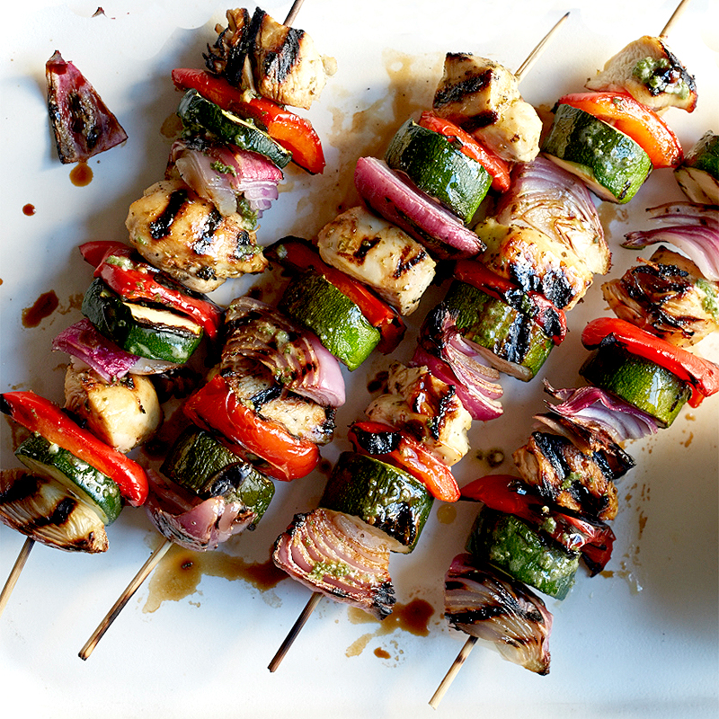 Photo of Mojo-marinated chicken and vegetable kebabs with mixed greens by WW