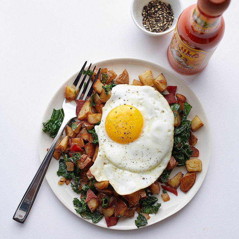 Photo of Egg over red potato, kale and bacon hash by WW