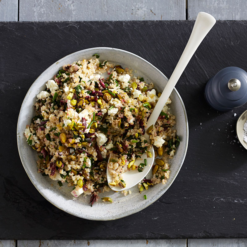 Photo of Beet greens and bulgur salad with feta and pistachios by WW