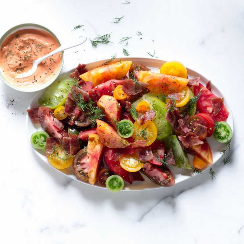 Photo of Heirloom tomato salad with bacon and tomato dill dressing by WW