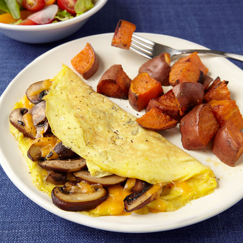 Photo of Classic Omelet with Roasted Sweet Potatoes by WW