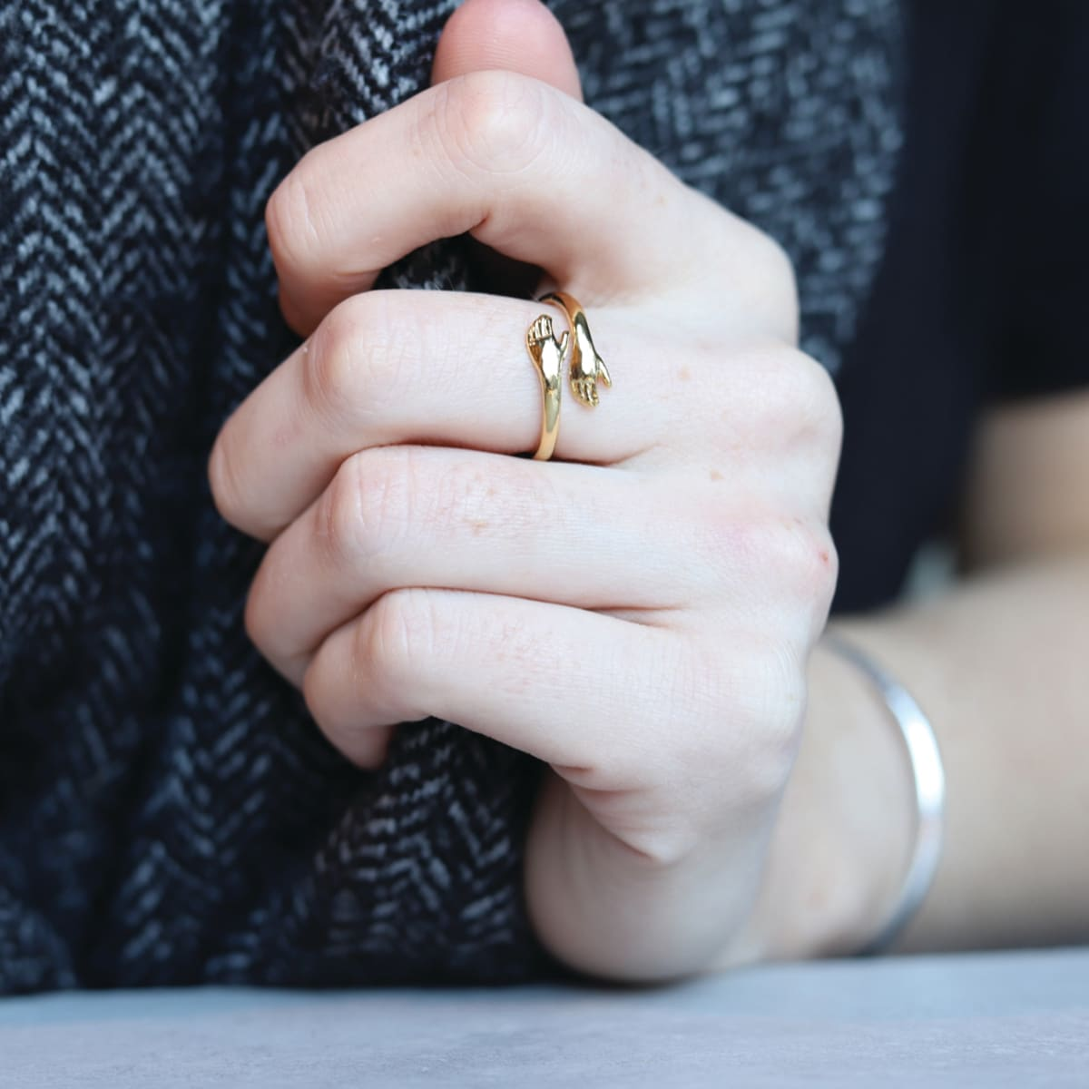 Hug Me Ring, colour gold, adjustable to make a comfortable fit from sizes C - Z, comes in an organza bag with a keepsake card