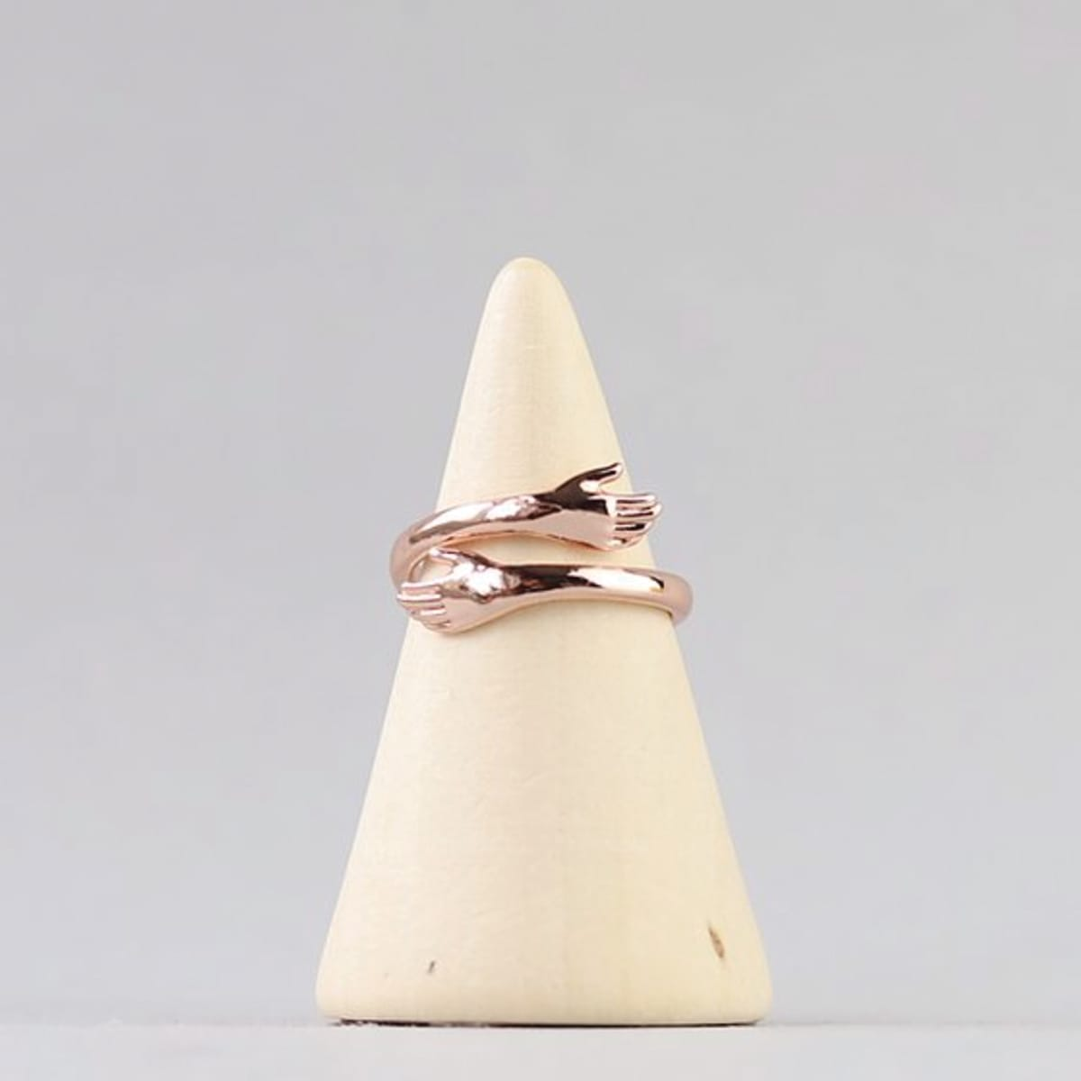 Hug Me Ring, colour rose gold, adjustable to make a comfortable fit from sizes C - Z, comes in an organza bag with a keepsake card