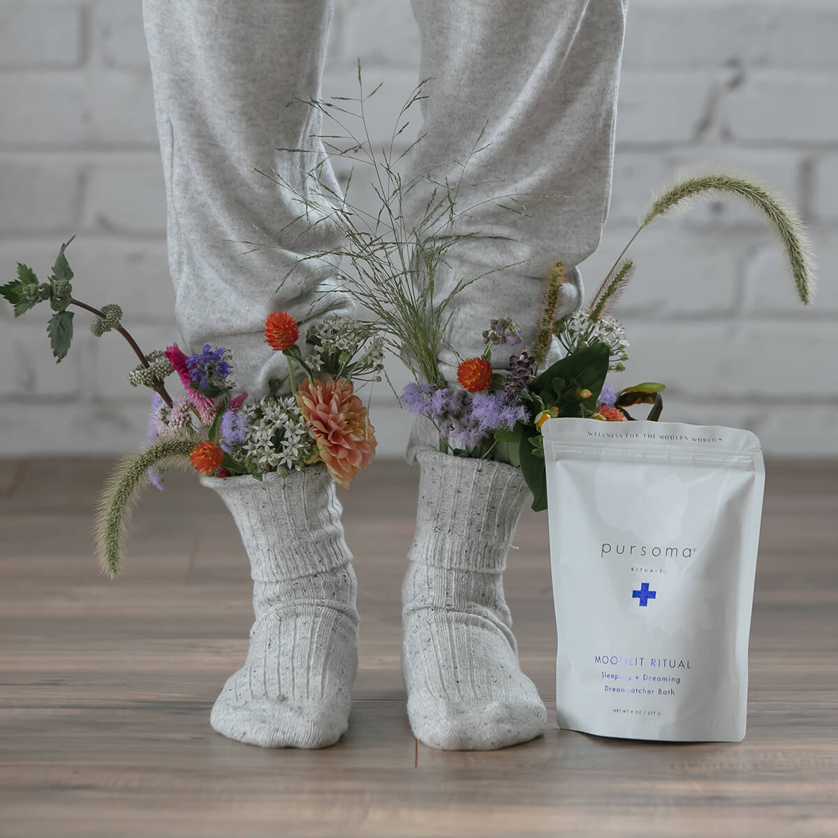 Pursoma Moonlit Ritual Bath Soak - bag on floor with flowers